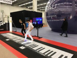 Giant floor piano at IMEX Frankfurt attended by Central Hall Westminster